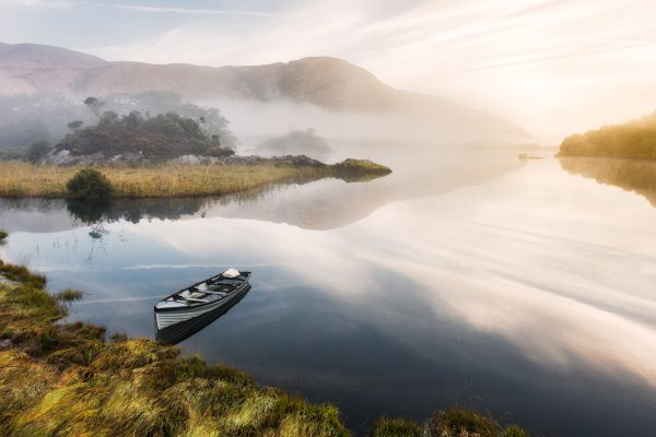 sunrise over lake in Ireland with boat